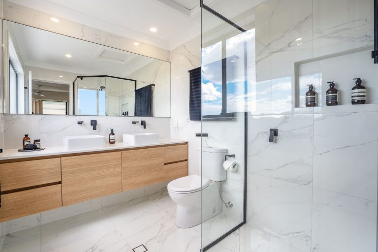 main ensuite bathroom robina shower, wooden vanity, black fittings, marble tiles, nook and lots of natural light
