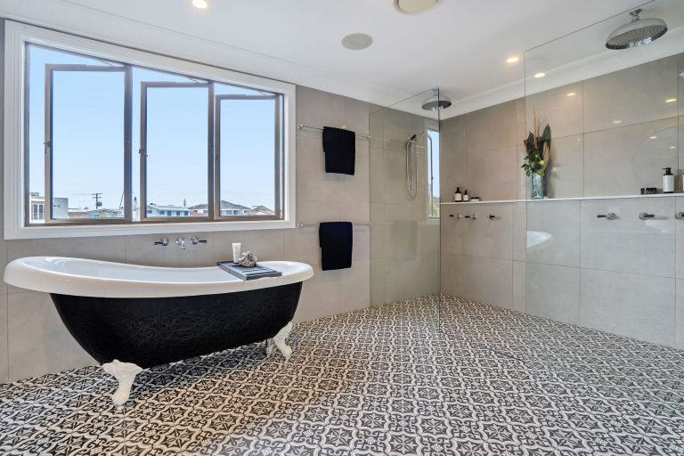 luxury bathroom freestanding bath, double shower, lots of natural light