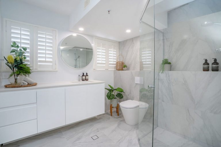 new bathroom with big marble look tiles, large vanity and big shower area