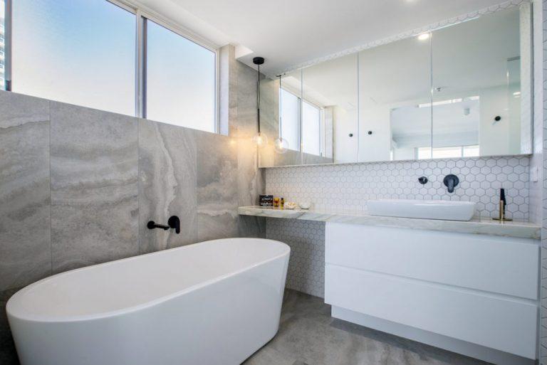 new bathroom with freestanding bath, black fittings, big shaving cabinet vanity mirror