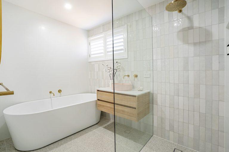 new bathroom with walk in shower, freestanding bath, concrete pink basin