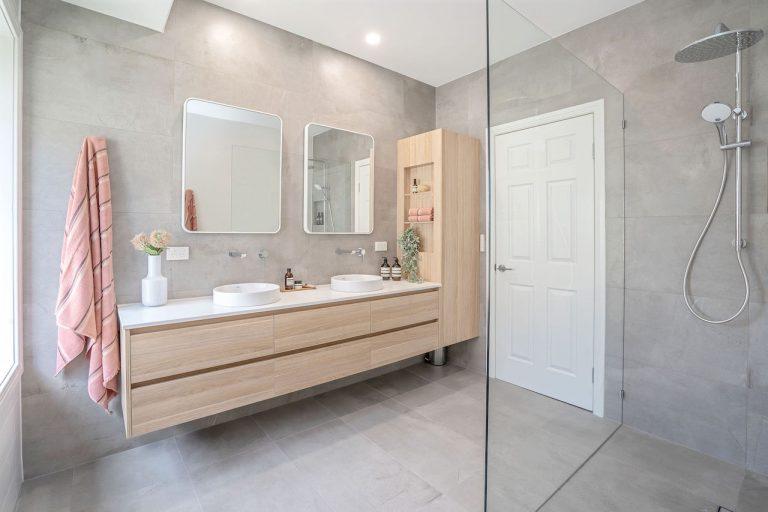 modern bathroom, grey tiles, wooden vanity, double sink 7 mirrors big shower head